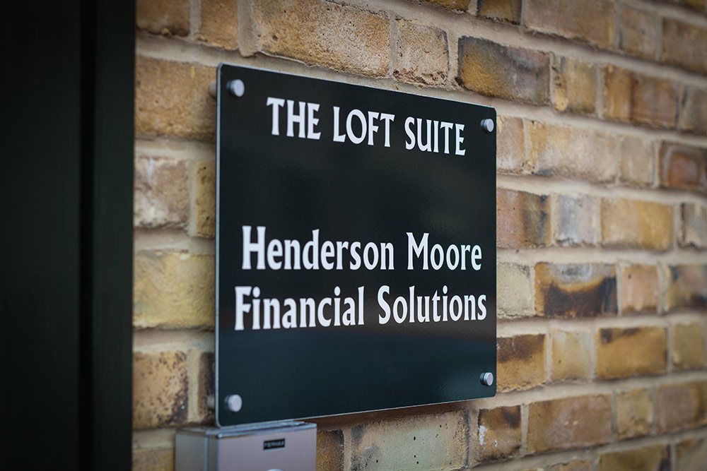 Photo of the outside sign of the Henderson Moore building